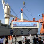 A container is loaded onto a ship during the inauguration of container service in Gwadar on May 11. China and Pakistan have agreed to build an economic corridor that will run from the Pakistani port to western China. Huang Zongzhi/Xinhua/Landov