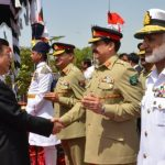 China's President Xi Jinping (left) greets Pakistan's army chief Gen. Raheel Sharif in Islamabad, Pakistan, on April 20. During Xi's visit, the two sides launched an ambitious $46 billion economic corridor linking Pakistan's port of Gwadar with western China. Press Information Department via AP