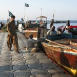 Fishermen at the harbor in Gwadar, a remote fishing town on Pakistan's southwestern coast. China is investing billions to create a large port in Gwadar and develop a transportation network that will lead to western China. It's part of the larger Chinese effort to build a modern Silk Road. Philip Reeves/NPR